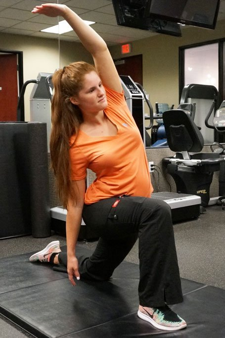 psoas stretch helps to avoid back injury by NW Injury & Rehab Center
