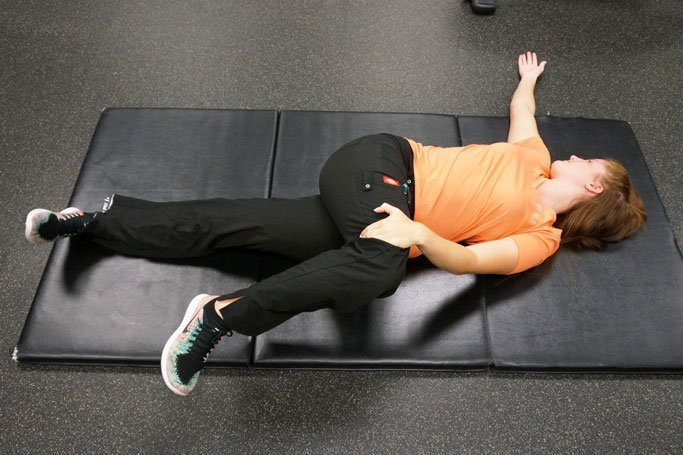 supine spinal twist to help avoid back injury