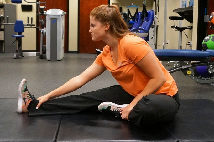 NW injury and rehab sitting toe touch stretch to avoid back injury