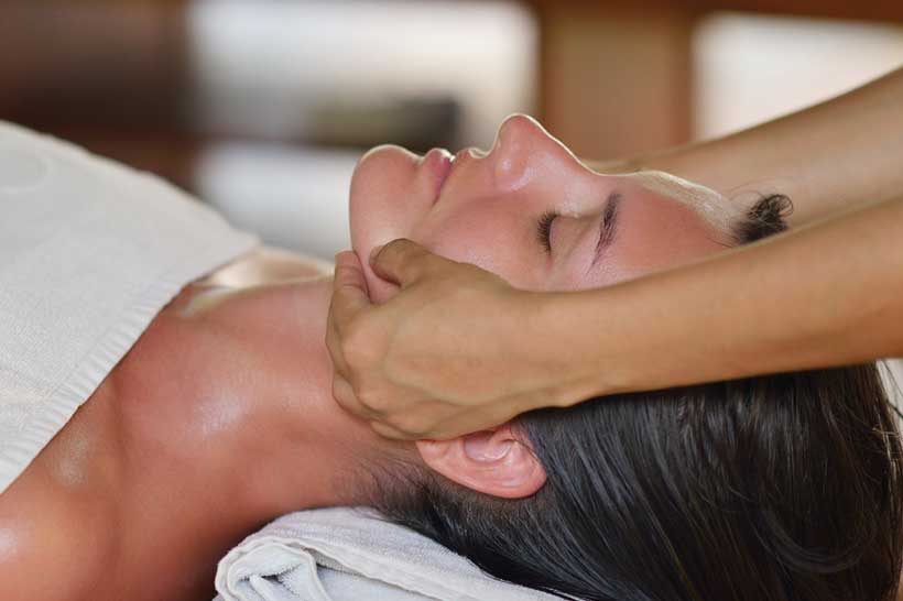 Image of woman getting a whiplash massage